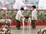 ketua-tim-pkk-provinsi-sulut-melantik-rita-mantiri-tangkudung-rabu-3132021.jpg