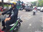 kondisi-jalan-arie-lasut-singkil-manado-sulawesi-utara-pasca-hujanggfj.jpg