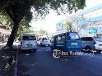 kondisi-lalu-lintas-jalan-sam-ratulangi-manado-sulawesi-utara-sabtu-2142018_20180421_134928.jpg