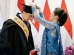 momen-wisuda-s3-edhie-baskoro-yudhoyono-atau-ibas-yudhoyono-didampingi-sang-istri-aliya-rajasa.jpg