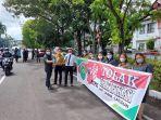 para-pegawai-pengadilan-bitung-melakukan-kampanye-tolak-korupsi-di-jalan-protokol-dr-sam-ratulangi.jpg