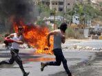 para-pemuda-palestina-melakukan-demonstrasi-1212.jpg