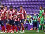 pemain-atletico-madrid-memasuki-lapangan-saat-pertandingan-sepak-bola-liga-spanyol.jpg