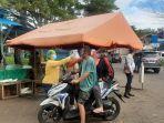 pengunjung-pasar-wilken-tomohon-ukur-suhu-tubuh.jpg