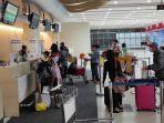 penumpang-di-terminal-keberangkatan-bandara-internasional-sam-ratulangi-manado.jpg