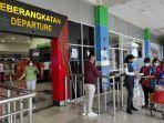 penumpang-udara-melonjak-di-bandara-sam-ratulangi-manado-selasa-18052021.jpg