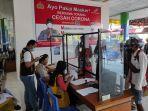 penumpang-wajib-jalani-pemeriksaan-dokumen-kesehatan-di-bandara-sam-ratulangi-manado.jpg