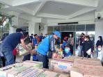 penyerahan-bantuan-donasi-konsumen-alfamidi-bagi-para-korban-bencana-alam.jpg