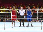 petinju-sulut-farrand-papendang-merah-meraih-medali-emas-nomor-64-kg-putra.jpg