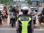petugas-kepolisian-dan-anggota-dishub-595950.jpg