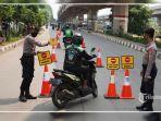 petugas-melakukan-penyekatan-mobilisasi-3474373.jpg