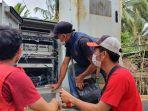 petugas-sedang-melakukan-pemulihan-jaringan-dan-layanan-di-daerah-terdampak-musibah.jpg