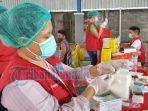 petugas-vaksinasi-covid-19-di-sulawesi-utara-sulut.jpg