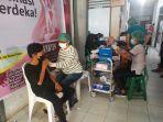 proses-vaksinasi-di-kabupaten-bolmongbbvbvb.jpg