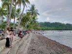 ratusan-pengunjung-datang-ke-pantai-modisi.jpg