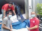 relawan-kkss-manado-bersama-ikami-sul-se-bantu-korban-banjir.jpg