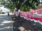 salah-satu-pedagang-di-boltim-jualan-bendera-jelang-hut-76575.jpg