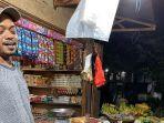 salah-satu-penjual-bahan-pokok-di-pasar-serasi-kotamobagu.jpg
