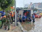 satgas-banjir-lantamal-iii-bantu-kendalikan-banjir-di-jakarta.jpg