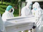 satgas-pemakaman-covid-19-pol-pp-minsel-5765fh.jpg
