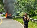 satu-mobil-yang-memuat-puluhan-tabung-terbakar-di-desa-tumuyu-kabupaten-blmnghjhjhj6868.jpg