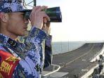 seorang-pelaut-china-sedang-memantau-situas_20180214_150306.jpg
