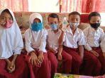 siswa-di-bolsel-mulai-terbiasa-pakai-masker-saat-belajar-dari-rumah1.jpg