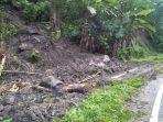 tanah-longsor-sempat-tutup-ruas-jalan-kotabunan-buyat-warga-sarankan-pengendara-hati-hati.jpg