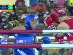 tlet-muaythai-sulut-joven-tawaluyan-biru-lolos-ke-semifinal-setelah-menang-atas-wakil-kaltim.jpg