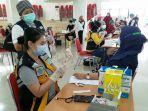 vaksinasi-covid-19-di-kabupaten-minahasa123.jpg