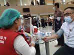 vaksinasi-covid-19-sudah-berlangsung-dua-bulan-lebih-di-provinsi-sulut.jpg