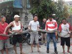 warga-temukan-ular-sanca-sepanjang-lebih-dari-4-meter-dalam-sebuah-kontrakan_20180904_225004.jpg
