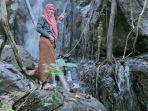 wisata-alam-air-terjun-di-desa-busato-kabupaten-bolmut-sulut.jpg