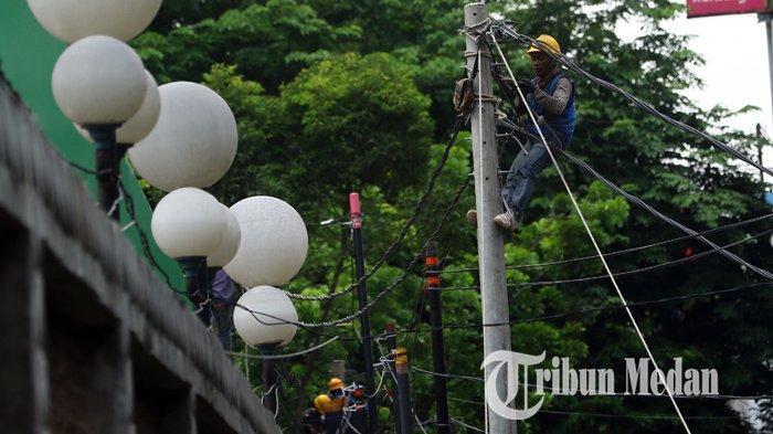 Berita Foto: Pengerjaan Jaringan Listrik Guna Mengurangi Gangguan yang Mengakibatkan Pemadaman - 13092109_perbaikan_jaringan_listrik_danil_siregar-2.jpg