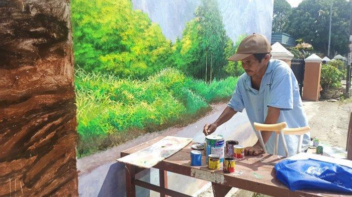 Sosok Andi Firman, Pelukis Disabilitas Asal Medan, Hasilkan Ratusan Mural di Tengah Keterbatasan