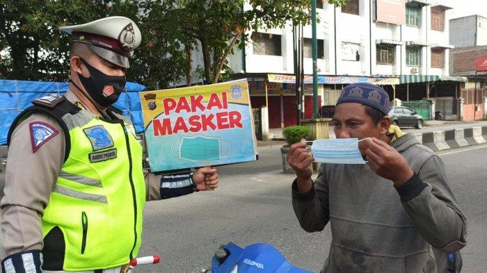 Cegah Penyebaran Virus Corona, Polres Tanjungbalai Bagikan Masker kepada Pengguna Jalan Setiap Hari