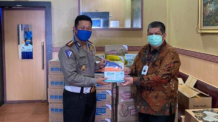 Bank Sumut Salurkan Bantuan Masker dan Vitamin Kepada Petugas Operasi Ketupat Toba