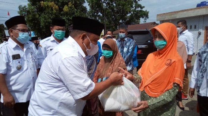 IPHI dan Baznas Langkat Beri Bantuan, Bupati Terbit Ingatkan Warga agar Tak Lupa Berzakat