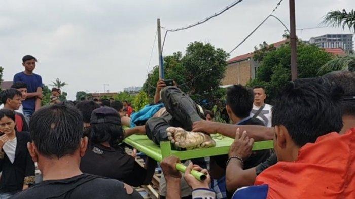 Setelah 20 Jam Pencarian, Mayat Dani yang Hanyut di Sungai Sikambing Ditemukan di Bawah Rel Kereta