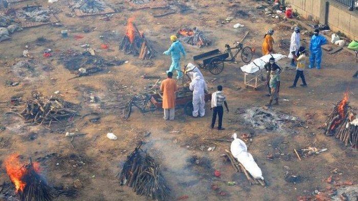 Kremasi massal jenazah penderita <a href='https://manado.tribunnews.com/tag/covid-19-di-india' title='Covid-19diIndia'>Covid-19diIndia</a>