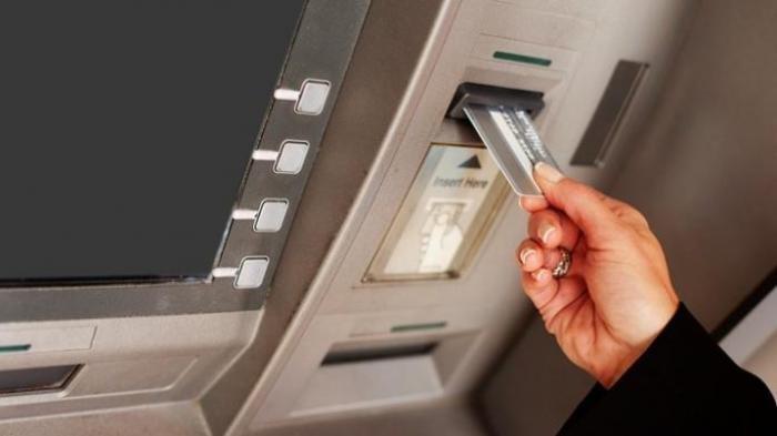 Ilustrasi ATM. (KOMPAS.COM)