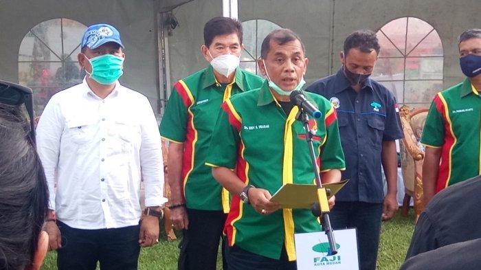 Ketua KONI Medan Eddy Sibarani saat menghadiri acara FAJI Medan.