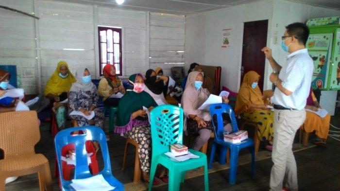 STIE Mikroskil Bekali Pengetahuan Kewirausahaan kepada Masyarakat Kampung Nelayan Seberang