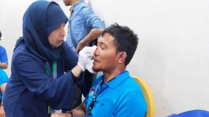 Kena Lempar Kursi, Wajah Ketua PAN Medan HT Bahrumsyah Berdarah