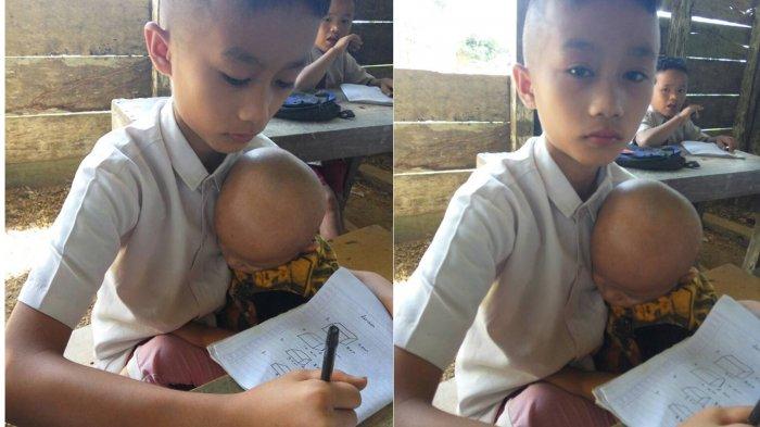 Mengharukan, Murid SD Nias Ini Terpaksa Gendong Adik Balitanya Saat Belajar di Sekolah