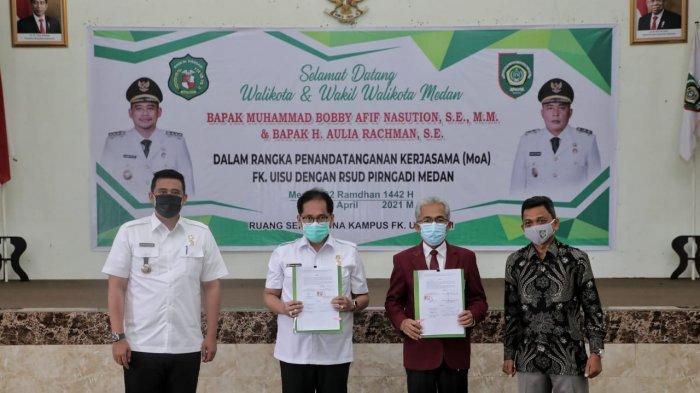Walikota Medan Muhammad Bobby Afif Nasution SE MM dan Rektor Universitas Islam Sumatera Utara (UISU) Dr Yanhar Jamaluddin menandatangani Nota Kesepahaman antara Pemko Medan dengan UISU di Aula Gedung Fakultas Kedokteran UISU, Jln STM, Medan Johor, Rabu (14/4/2021).