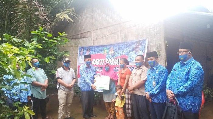 Peringati HUT Korpri ke-49, Pemkab Langkat Menggelar Bansos Bedah Rumah