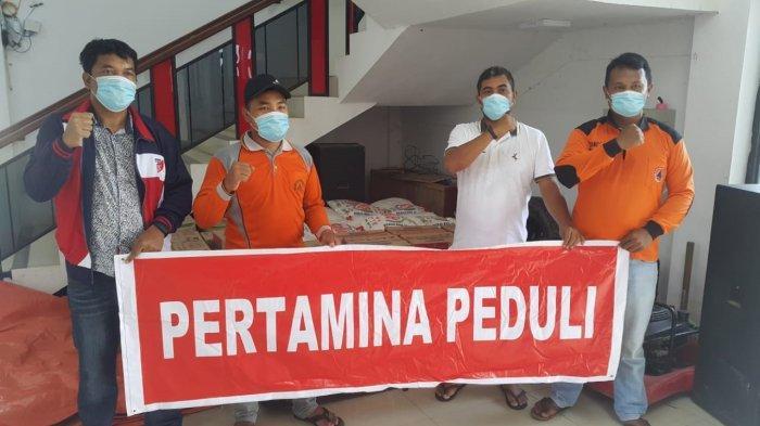 Pertamina Peduli Bagikan 200 Paket Sembako untuk Bantu Korban Banjir di Labuhanbatu Utara