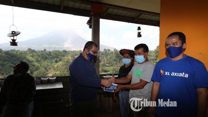 BERITA FOTO Dukung Liputan Bencana Sinabung, XL Axiata Menyediakan Internet Gratis di Warung Anto