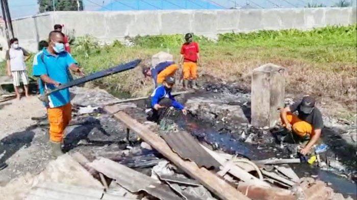 Tawuran dan Penjarahan di Belawan, Petugas Bersama Warga Perbaiki Rumah Rusak dan Bersihkan Bebatuan